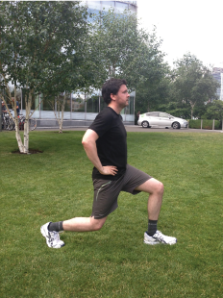 Lunge: Large step forward, with hands on hips. Leading leg parallel to the floor with your knee at 90 degrees and nicely in line with the front of the foot. Drive back up through the heal and repeat on the opposite leg. Make sure your back leg doesn't touch the floor